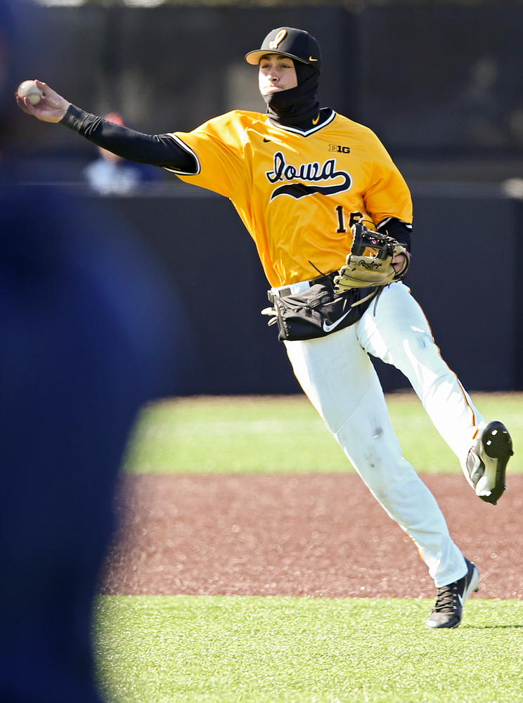 Iowa Hawkeyes shortstop Tanner Wetrich (16) throw to first for the final out in the ninth inning against Illinois at Duane Banks Field in Iowa City on Sunday, Mar. 31, 2019. (Stephen Mally/hawkeyesports.com)