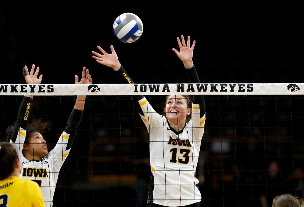 Iowa Hawkeyes middle blocker Sarah Wing (13) and setter Gabrielle Orr (7) against the Michigan Wolverines Sunday, September 23, 2018 at Carver-Hawkeye Arena. (Brian Ray/hawkeyesports.com)