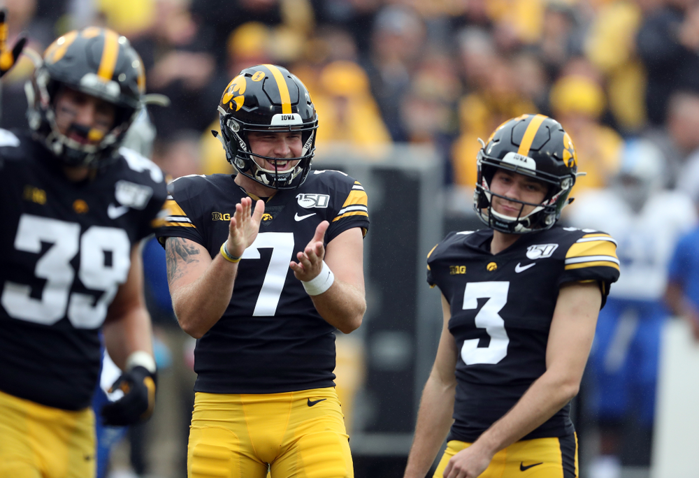 Iowa Hawkeyes punter Colten Rastetter (7) reacts after beating place kicker Keith Duncan (3) at rock paper scissors following a kick against Middle Tennessee State Saturday, September 28, 2019 at Kinnick Stadium. (Brian Ray/hawkeyesports.com)