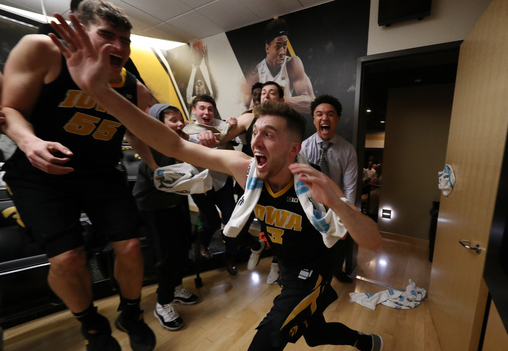 Iowa Hawkeyes guard Jordan Bohannon (3) celebrates with his teammates after defeating the Indiana Hoosiers in overtime Friday, February 22, 2019 at Carver-Hawkeye Arena. (Brian Ray/hawkeyesports.com)