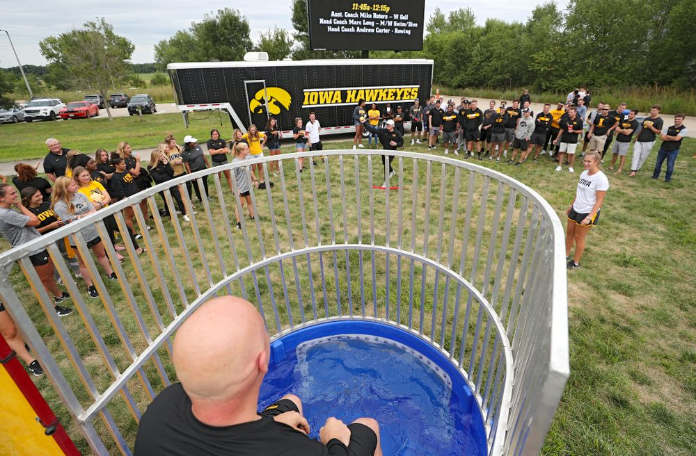Iowa Baseball assistant coach Robin Lund sits in the dunk tank during the Student-Athlete Kickoff outside the Karro Athletics Hall of Fame Building in Iowa City on Sunday, Aug 25, 2019. (Stephen Mally/hawkeyesports.com)