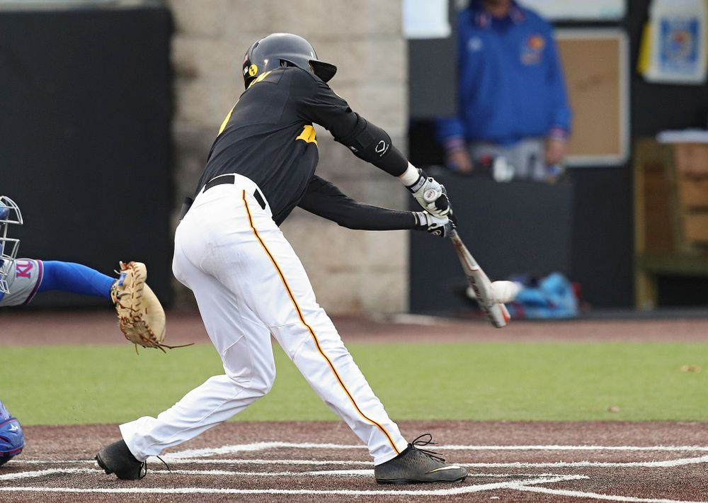 Iowa outfielder Ben Norman (9) gets a hit during the eighth inning of their college baseball game at Duane Banks Field in Iowa City on Tuesday, March 10, 2020. (Stephen Mally/hawkeyesports.com)