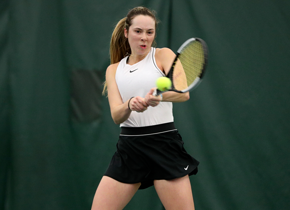 Iowa's Samantha Mannix returns a shot during her doubles match at the Hawkeye Tennis and Recreation Complex in Iowa City on Sunday, February 16, 2020. (Stephen Mally/hawkeyesports.com)