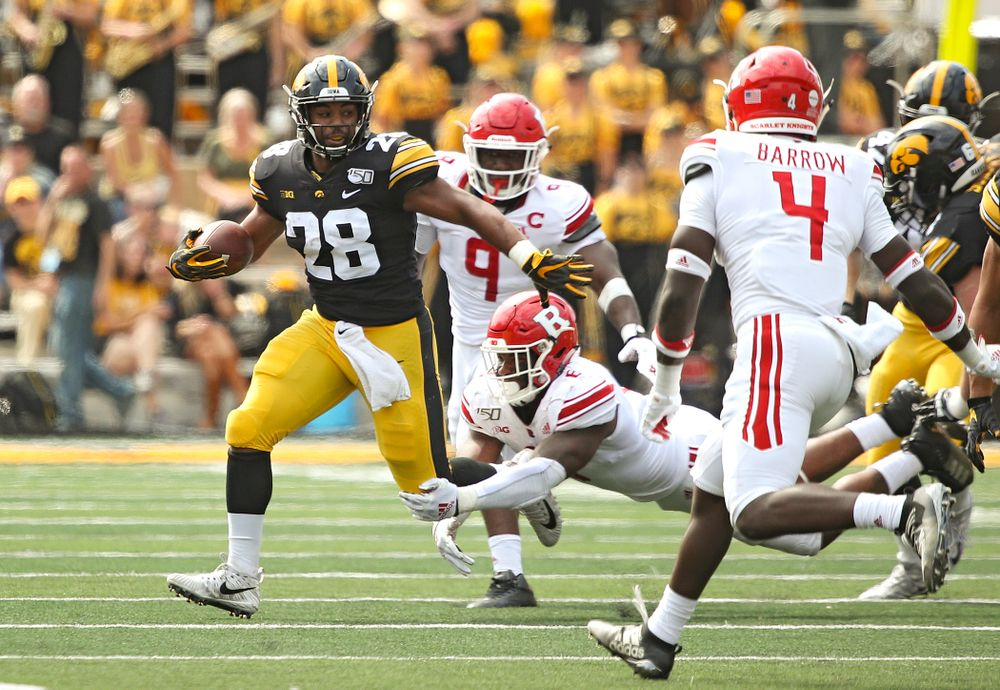 Iowa Hawkeyes running back Toren Young (28) pulls away from a tackle during the second quarter of their Big Ten Conference football game at Kinnick Stadium in Iowa City on Saturday, Sep 7, 2019. (Stephen Mally/hawkeyesports.com)