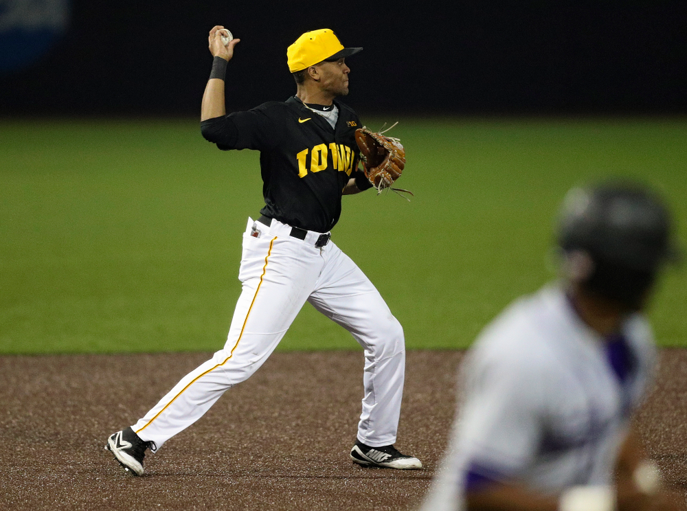 Iowa Hawkeyes third baseman Lorenzo Elion (1) throws to second base to start a double play during the seventh inning of their game against Western Illinois at Duane Banks Field in Iowa City on Wednesday, May. 1, 2019. (Stephen Mally/hawkeyesports.com)