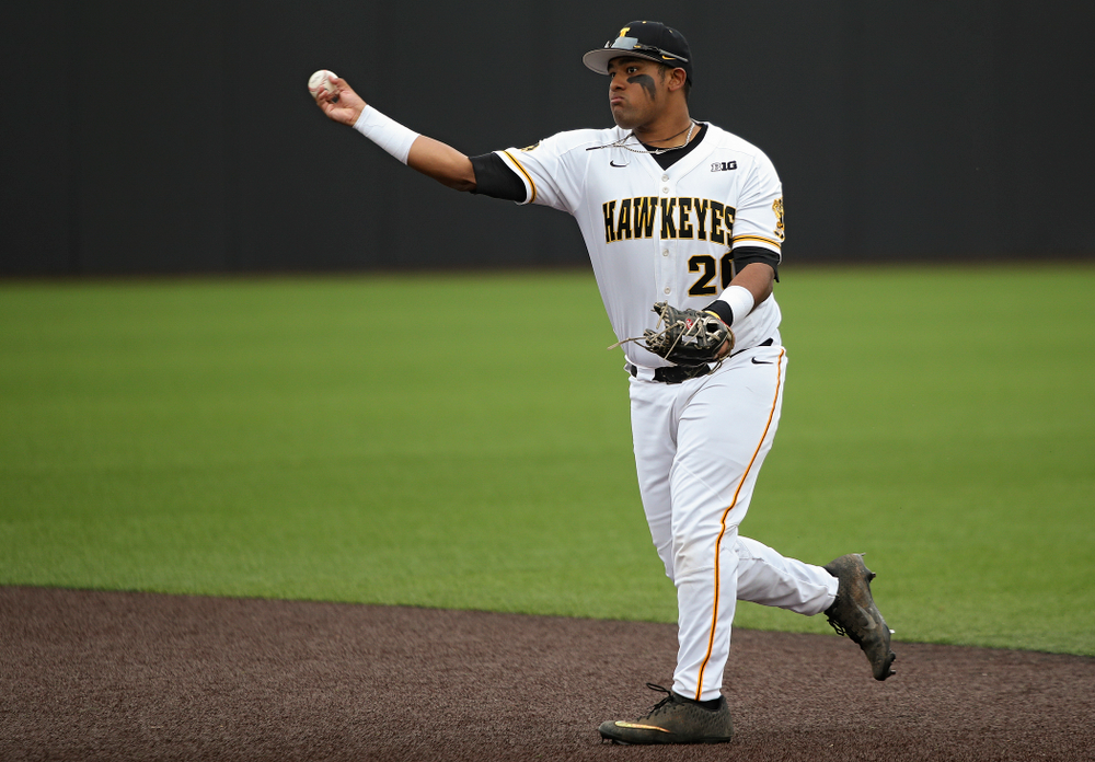 Iowa second baseman Izaya Fullard (20) throws to first base for an out during the first inning of their college baseball game at Duane Banks Field in Iowa City on Wednesday, March 11, 2020. (Stephen Mally/hawkeyesports.com)