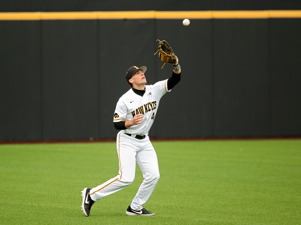 Iowa left fielder Brayden Frazier (4) pulls in a fly ball for an out during the fifth inning of their college baseball game at Duane Banks Field in Iowa City on Wednesday, March 11, 2020. (Stephen Mally/hawkeyesports.com)