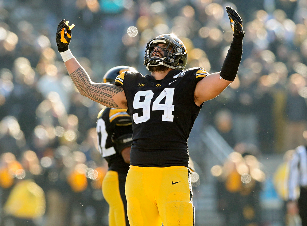 Iowa Hawkeyes defensive end A.J. Epenesa (94) pumps up the crowd during the fourth quarter of their game at Kinnick Stadium in Iowa City on Saturday, Nov 23, 2019. (Stephen Mally/hawkeyesports.com)
