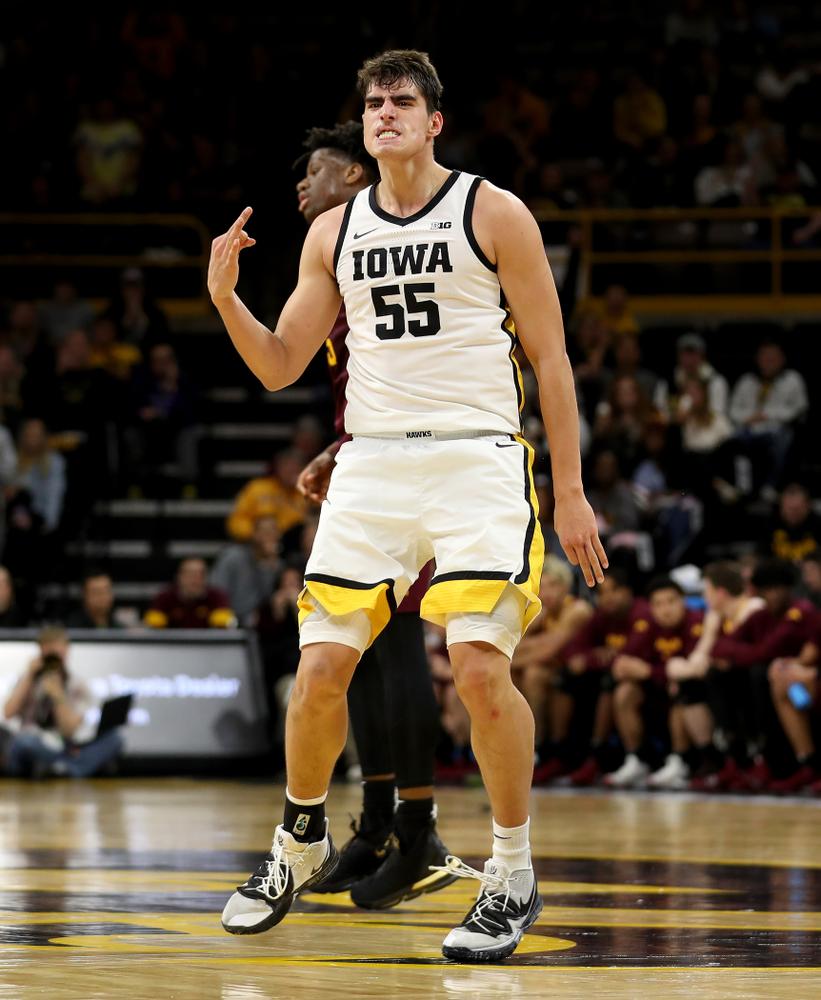 Iowa Hawkeyes forward Luka Garza (55) celebrates a three point basket against the Minnesota Golden Gophers Monday, December 9, 2019 at Carver-Hawkeye Arena. (Brian Ray/hawkeyesports.com)