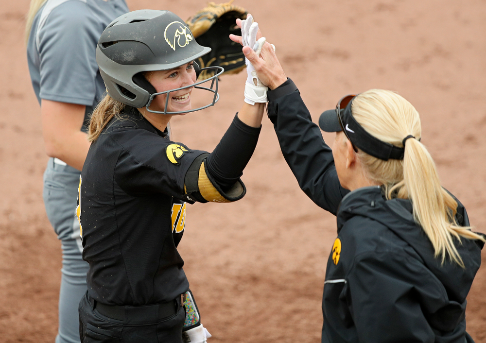 Iowa's Aralee Bogar (2) gets a high-five from head coach Renee Gillispie during the fourth inning of their game against Iowa Softball vs Indian Hills Community College at Pearl Field in Iowa City on Sunday, Oct 6, 2019. (Stephen Mally/hawkeyesports.com)