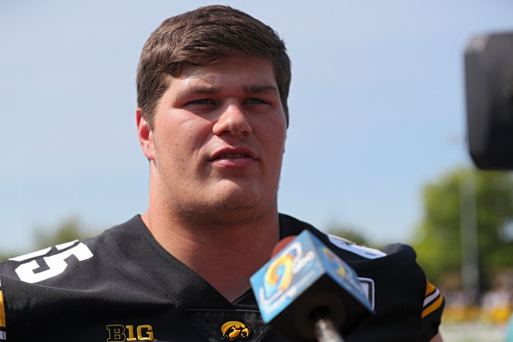 Iowa Hawkeyes offensive lineman Tyler Linderbaum (65) answers questions during Iowa Football Media Day at the Hansen Football Performance Center in Iowa City on Friday, Aug 9, 2019. (Stephen Mally/hawkeyesports.com)
