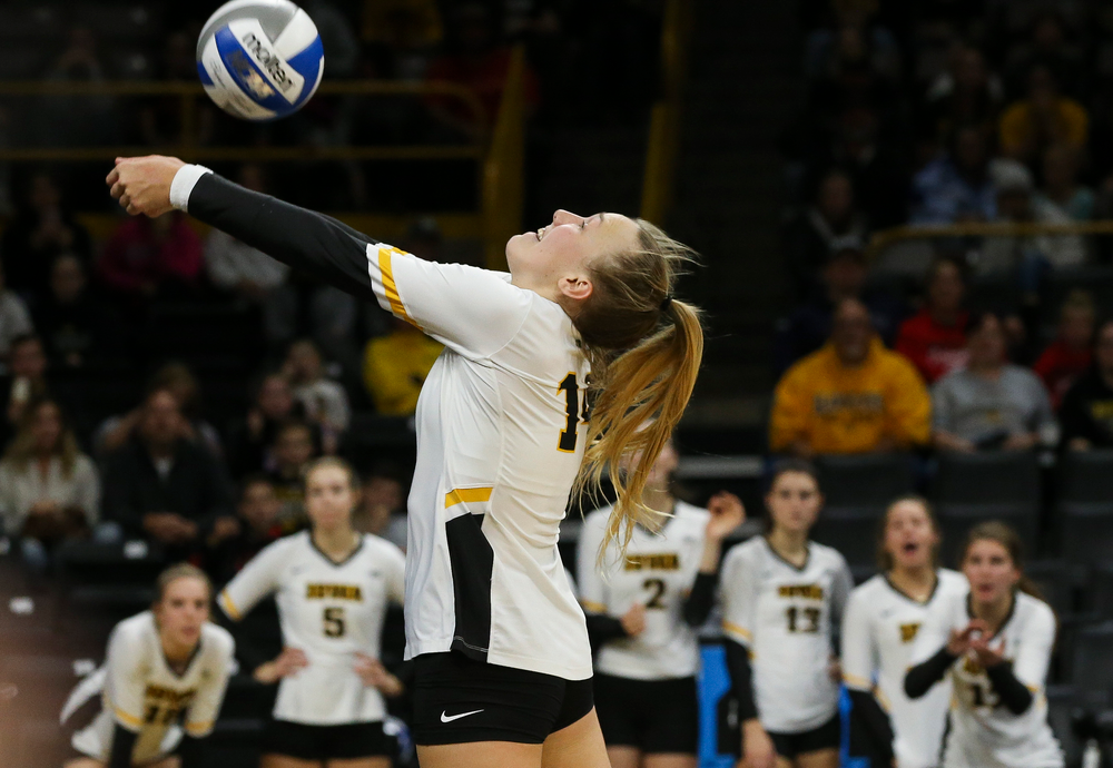 Iowa Hawkeyes outside hitter Cali Hoye (14) bumps the ball during a game against Purdue at Carver-Hawkeye Arena on October 13, 2018. (Tork Mason/hawkeyesports.com)