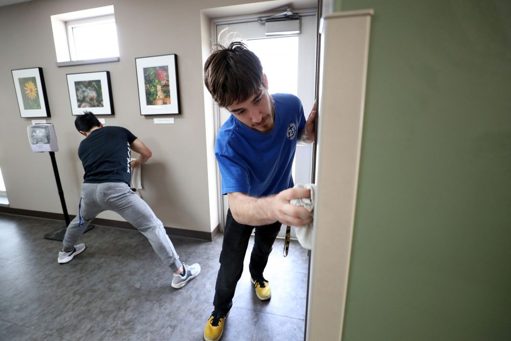 Members of the MenÕs Gymnastics team volunteer at CommUnity Crisis Services and Food Bank during the annual Iowa Athletics Day of Caring  Sunday, April 28, 2019 in Iowa City. (Brian Ray/hawkeyesports.com)