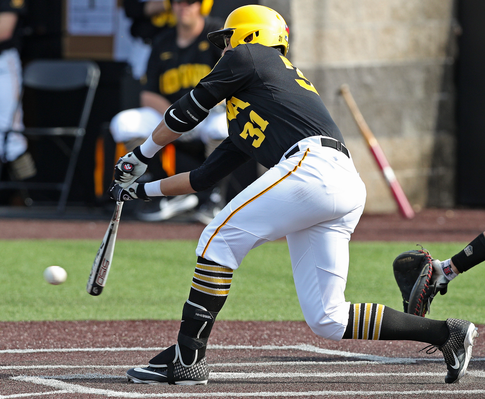 Iowa Hawkeyes third baseman Matthew Sosa (31) drives in a run with a hit during the sixth inning of their game against Rutgers at Duane Banks Field in Iowa City on Saturday, Apr. 6, 2019. (Stephen Mally/hawkeyesports.com)
