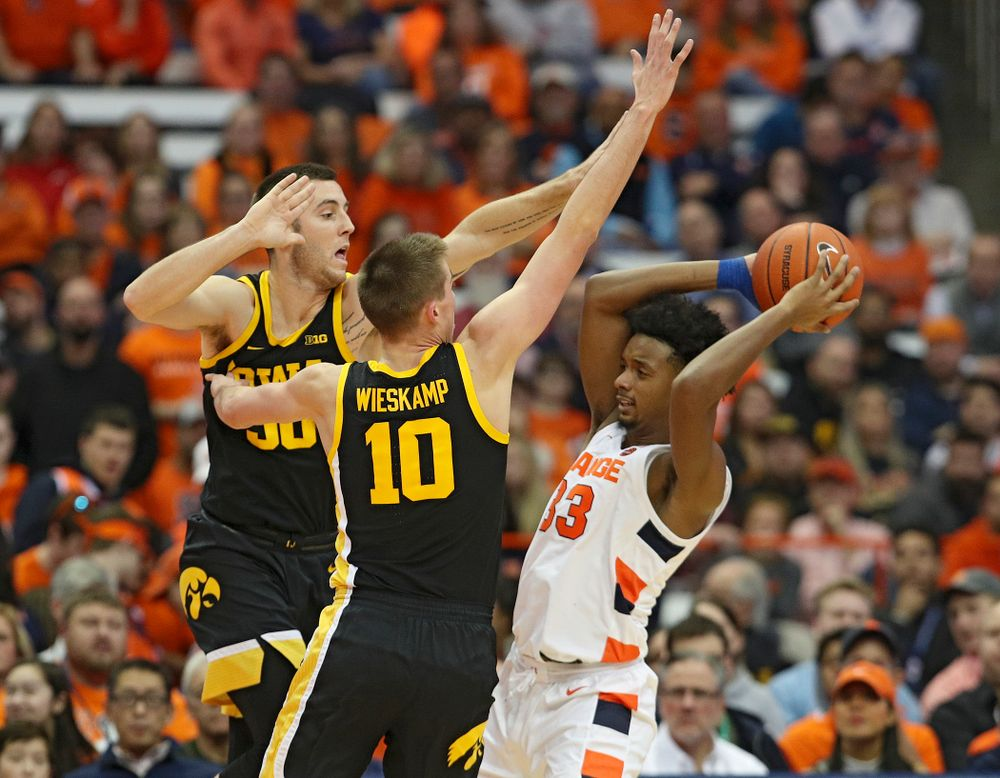 Iowa Hawkeyes guard Connor McCaffery (30) and guard Joe Wieskamp (10) pressure Syracuse Orange forward Elijah Hughes (33) during the second half of their ACC/Big Ten Challenge game at the Carrier Dome in Syracuse, N.Y. on Tuesday, Dec 3, 2019. (Stephen Mally/hawkeyesports.com)