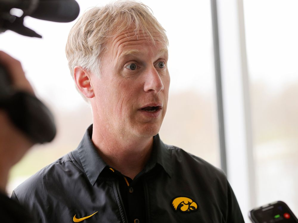 Iowa head coach Andrew Carter answers a question during media availability at the P. Sue Beckwith, M.D., Boathouse in Iowa City on Wednesday, Apr. 10, 2019. (Stephen Mally/hawkeyesports.com)