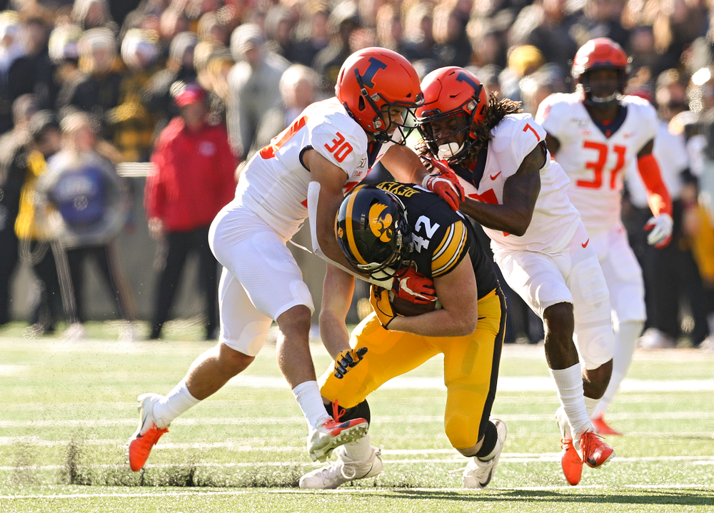 Iowa Hawkeyes tight end Shaun Beyer (42) pulls defenders with him after pulling in a pass during the second quarter of their game at Kinnick Stadium in Iowa City on Saturday, Nov 23, 2019. (Stephen Mally/hawkeyesports.com)