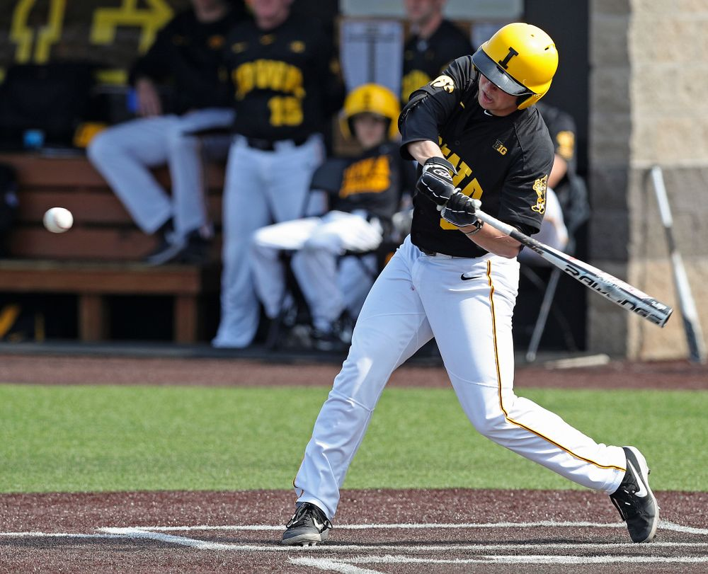 Iowa Hawkeyes first baseman Zeb Adreon (5) hits an RBI double during the fourth inning of their game against Rutgers at Duane Banks Field in Iowa City on Saturday, Apr. 6, 2019. (Stephen Mally/hawkeyesports.com)
