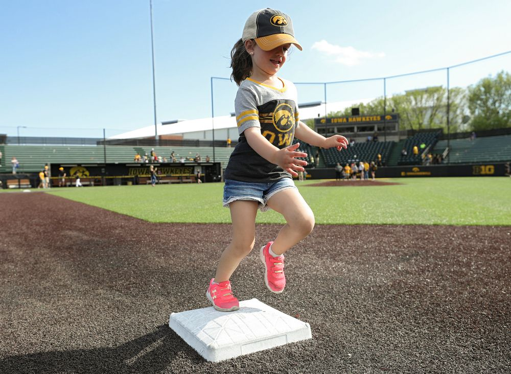 Kids run the bases after Iowa's game against UC Irvine at Duane Banks Field in Iowa City on Sunday, May. 5, 2019. (Stephen Mally/hawkeyesports.com)