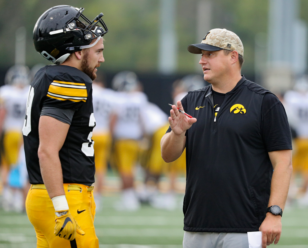 Iowa Hawkeyes tight end Nate Wieting (39) talks with offensive coordinator Brian Ferentz  durning Fall Camp Practice No. 17 at the Hansen Football Performance Center in Iowa City on Wednesday, Aug 21, 2019. (Stephen Mally/hawkeyesports.com)