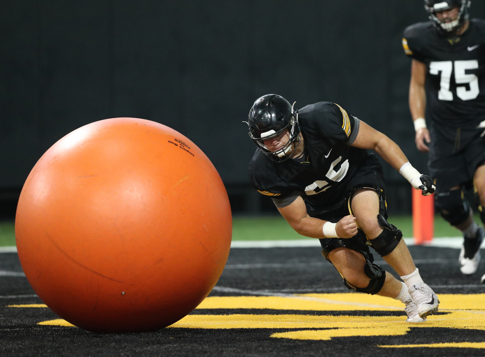 Iowa Hawkeyes offensive lineman Tyler Linderbaum (65) during Fall Camp Practice No. 16 Tuesday, August 20, 2019 at the Ronald D. and Margaret L. Kenyon Football Practice Facility. (Brian Ray/hawkeyesports.com)
