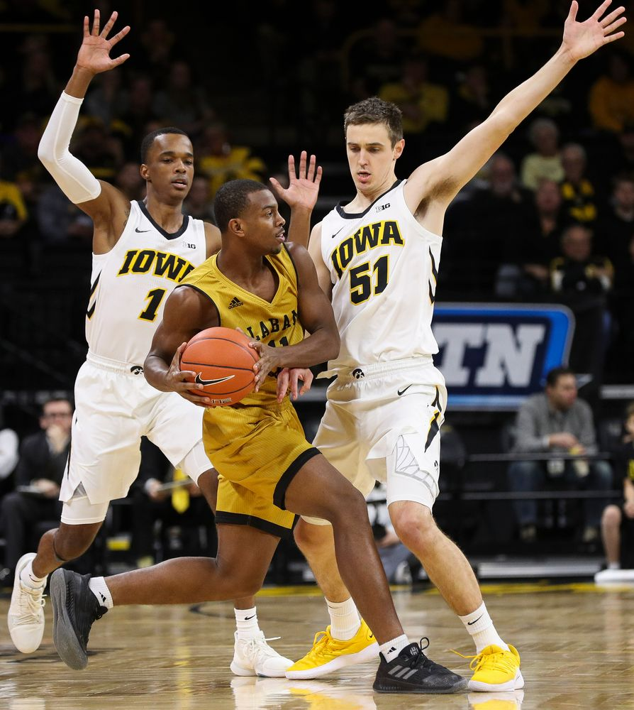 Iowa Hawkeyes guard Maishe Dailey (1) and Iowa Hawkeyes forward Nicholas Baer (51) trap a ballhandler during a game against Alabama State at Carver-Hawkeye Arena on November 21, 2018. (Tork Mason/hawkeyesports.com)