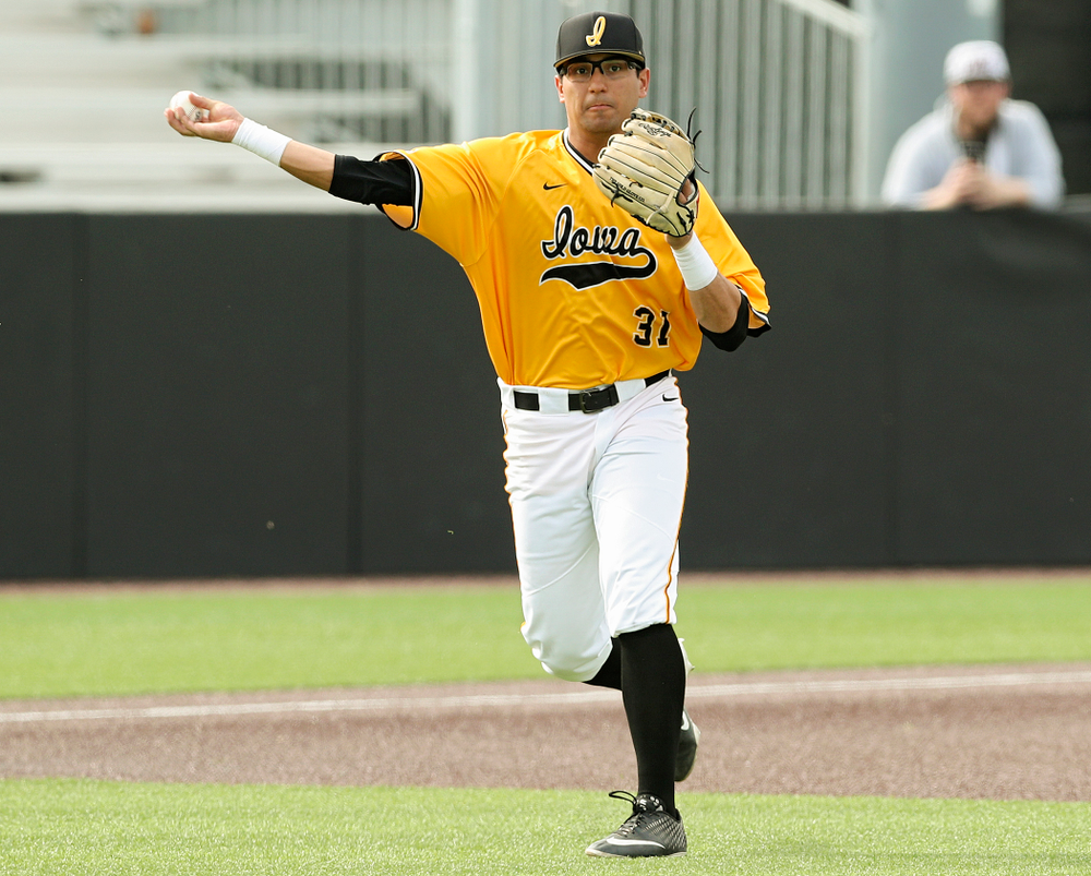 Iowa Hawkeyes third baseman Matthew Sosa (31) throws to first for an out during the first inning of their game against Northern Illinois at Duane Banks Field in Iowa City on Tuesday, Apr. 16, 2019. (Stephen Mally/hawkeyesports.com)