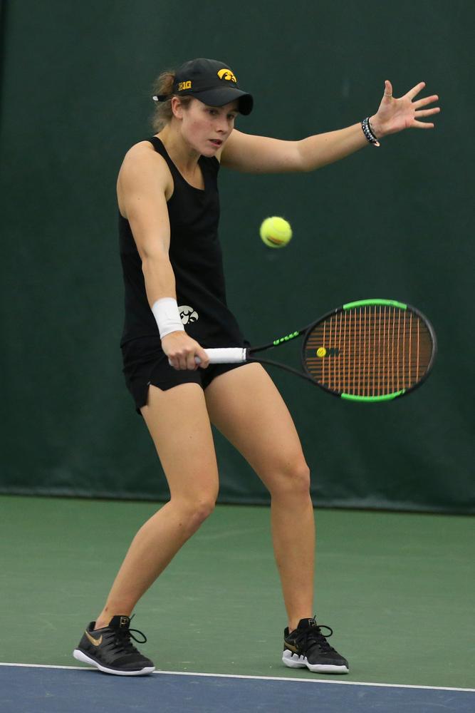 Iowa's Elise van Heuvelen Treadwell returns a hit during the Iowa women's tennis meet vs UNI  on Saturday, February 29, 2020 at the Hawkeye Tennis and Recreation Complex. (Lily Smith/hawkeyesports.com)