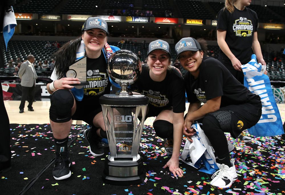 Iowa Hawkeyes seniors Megan Gustafson, Hannah Stewart, and Tania Davis celebrate their victory over the Maryland Terrapins in the Big Ten Championship Game Sunday, March 10, 2019 at Bankers Life Fieldhouse in Indianapolis, Ind. (Brian Ray/hawkeyesports.com)