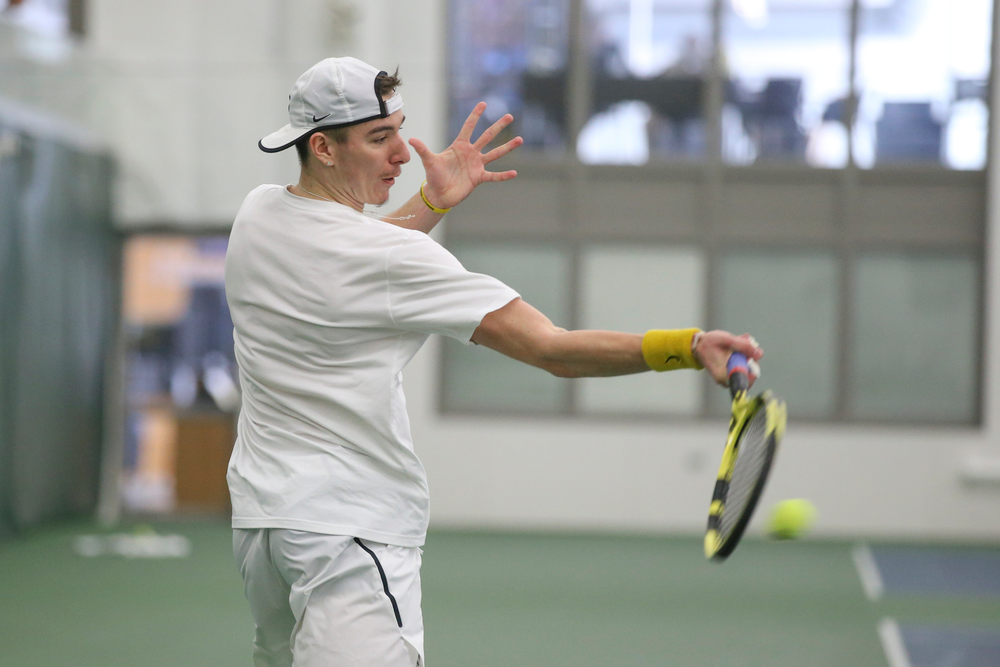 Iowa's Nikita Snezhko returns a hit during the Iowa men's tennis meet vs Nebraska on Sunday, March 1, 2020 at the Hawkeye Tennis and Recreation Complex. (Lily Smith/hawkeyesports.com)
