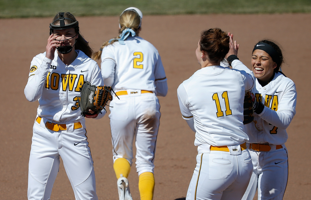 Iowa Hawkeyes pitcher Allison Doocy (3), Iowa Hawkeyes infielder Lea Thompson (7)