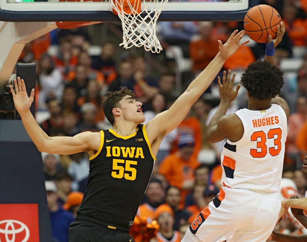 Iowa Hawkeyes center Luka Garza (55) blocks a shot by Syracuse Orange forward Elijah Hughes (33) during the second half of their ACC/Big Ten Challenge game at the Carrier Dome in Syracuse, N.Y. on Tuesday, Dec 3, 2019. (Stephen Mally/hawkeyesports.com)
