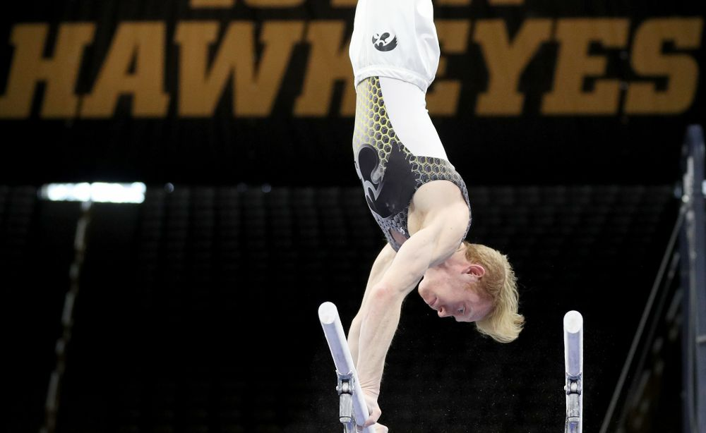 Iowa's Nick Merryman competes on the parallel bars against Illinois Sunday, March 1, 2020 at Carver-Hawkeye Arena. (Brian Ray/hawkeyesports.com)