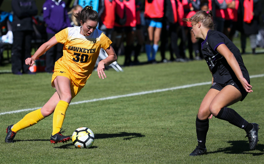 Iowa Hawkeyes forward Devin Burns (30) dribbles the ball during a game against Northwestern at the Iowa Soccer Complex on October 21, 2018. (Tork Mason/hawkeyesports.com)