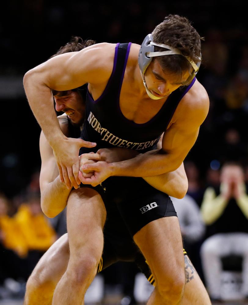 Iowa's Vince Turk wrestles Northwestern's Alec McKenna at 141 pounds