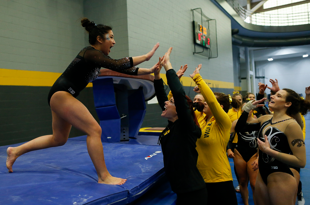 Nicole Chow celebrates after competing on the vault during the Black and Gold Intrasquad meet at the Field House on 12/2/17. (Tork Mason/hawkeyesports.com)