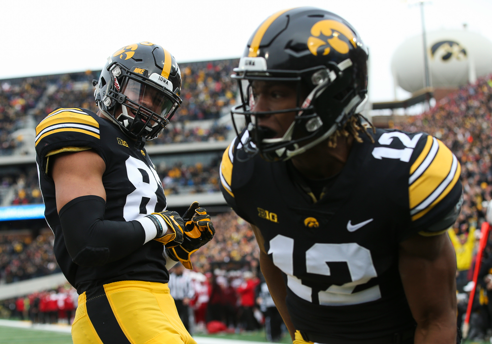 Iowa Hawkeyes tight end Noah Fant (87) celebrates after a touchdown scored by Iowa Hawkeyes wide receiver Brandon Smith (12) during a game against Nebraska at Kinnick Stadium on November 23, 2018. (Tork Mason/hawkeyesports.com)