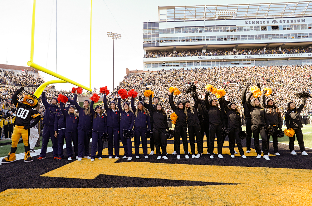 Iowa Spirit Squad members and Illinois Fighting Illini cheerleaders wave to the University of Iowa Stead Family Children's Hospital between the first and second quarter of their game at Kinnick Stadium in Iowa City on Saturday, Nov 23, 2019. (Stephen Mally/hawkeyesports.com)