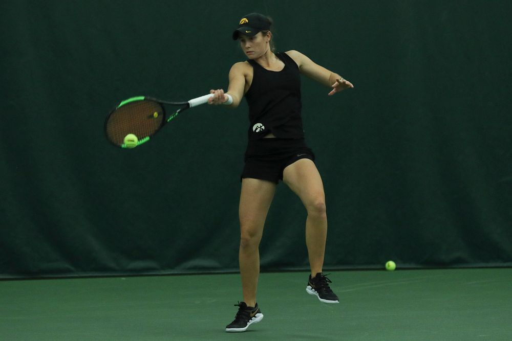 Iowa's Elise van Heuvelen during the Iowa women's tennis meet vs DePaul  on Friday, February 21, 2020 at the Hawkeye Tennis and Recreation Complex. (Lily Smith/hawkeyesports.com)