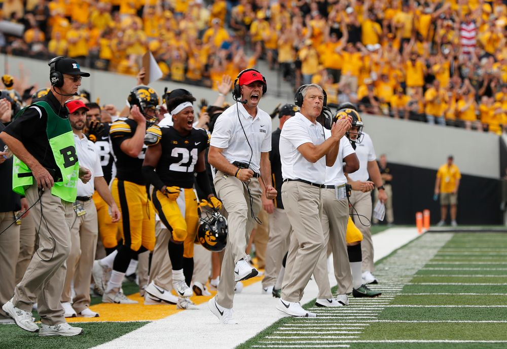 Iowa Hawkeyes head coach Kirk Ferentz  and offensive student assistant Declan Doyle celebrate a touchdown against the Northern Illinois Huskies Saturday, September 1, 2018 at Kinnick Stadium. (Brian Ray/hawkeyesports.com)