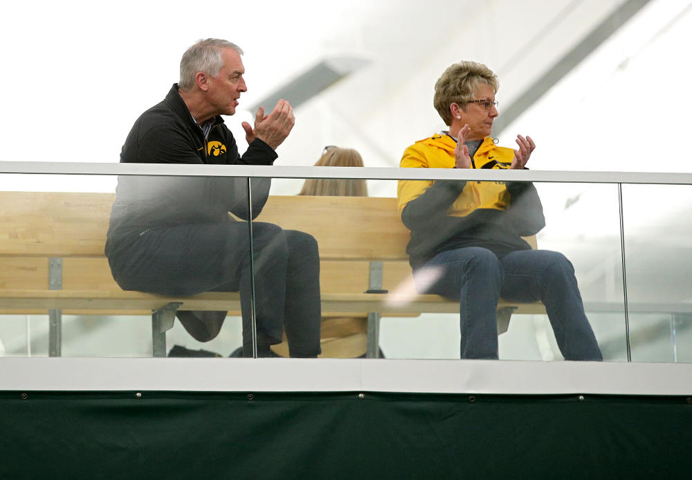 Henry B. and Patricia B. Tippie Director of Athletics Chair Gary Barta (from left) and Deputy Director of Athletics/Senior Woman Administrator Barbara Burke clap during a match at the Hawkeye Tennis and Recreation Complex in Iowa City on Sunday, February 23, 2020. (Stephen Mally/hawkeyesports.com)