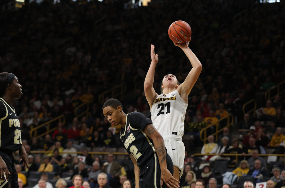 Iowa Hawkeyes forward Hannah Stewart (21) makes a basket and draws a foul against the Purdue Boilermakers Sunday, January 27, 2019 at Carver-Hawkeye Arena. (Brian Ray/hawkeyesports.com)