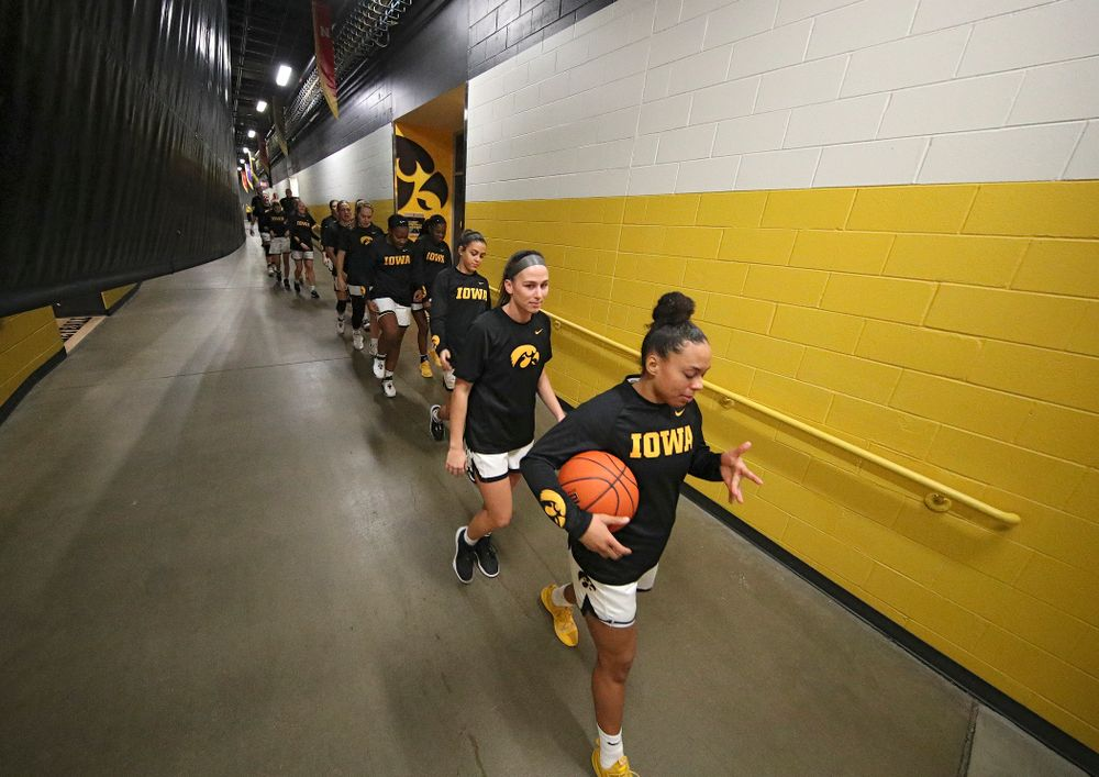 Iowa Hawkeyes guard Alexis Sevillian (5) leads her team to the floor before the start of their game at Carver-Hawkeye Arena in Iowa City on Sunday, January 12, 2020. (Stephen Mally/hawkeyesports.com)