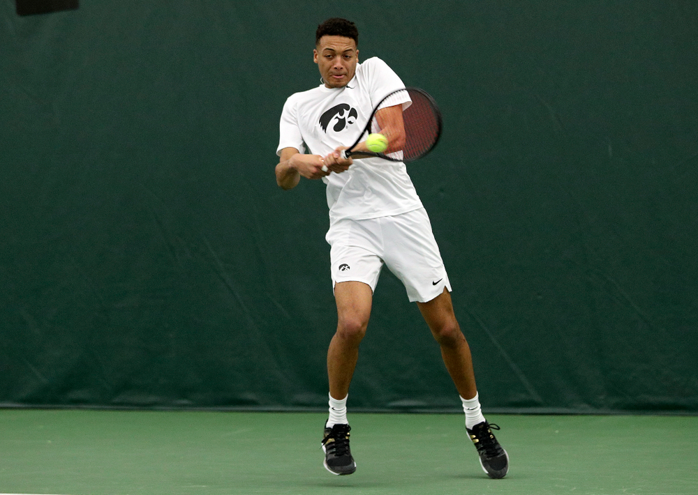 Iowa's Oliver Okonkwo returns a shot during his doubles match at the Hawkeye Tennis and Recreation Complex in Iowa City on Sunday, February 16, 2020. (Stephen Mally/hawkeyesports.com)