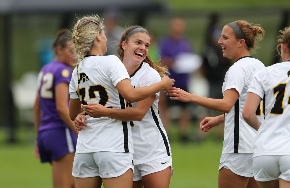 Iowa Hawkeyes forward Gianna Gourley (32) celebrates with Iowa Hawkeyes defender Riley Burns (33) after scoring during a 6-1 win over Northern Iowa Sunday, August 25, 2019 at the Iowa Soccer Complex. (Brian Ray/hawkeyesports.com)