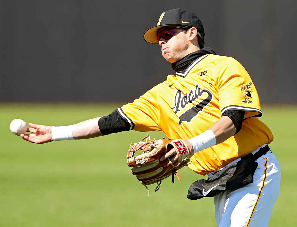 Iowa Hawkeyes second baseman Mitchell Boe (4) throws to first for an out during the fifth inning against Illinois at Duane Banks Field in Iowa City on Sunday, Mar. 31, 2019. (Stephen Mally/hawkeyesports.com)