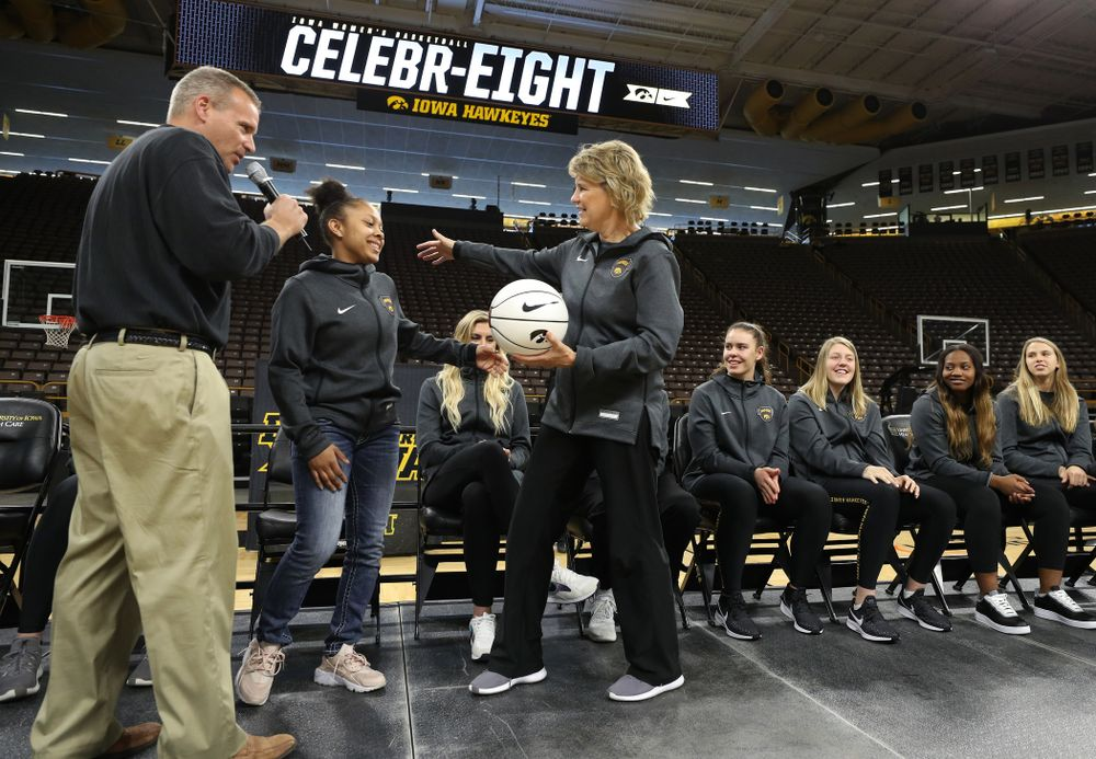 Iowa Hawkeyes head coach Lisa Bluder presents guard Tania Davis (11) with a ball commemorating her 1,00th point during the teamÕs Celebr-Eight event Wednesday, April 24, 2019 at Carver-Hawkeye Arena. (Brian Ray/hawkeyesports.com)