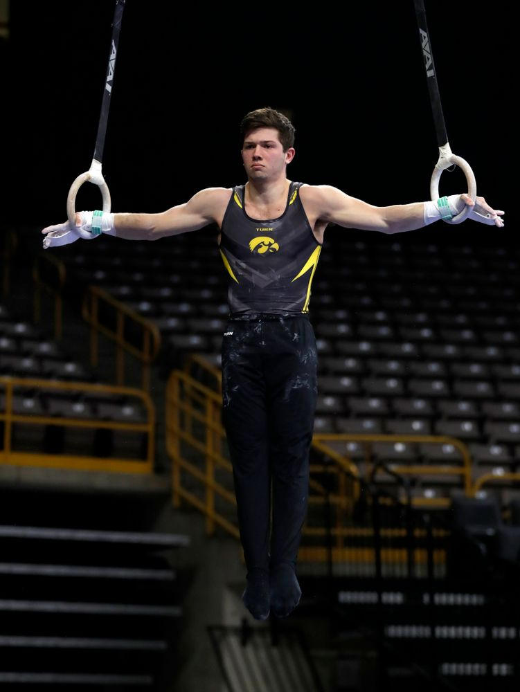 Rogelio Vazquez competes on the rings against Illinois