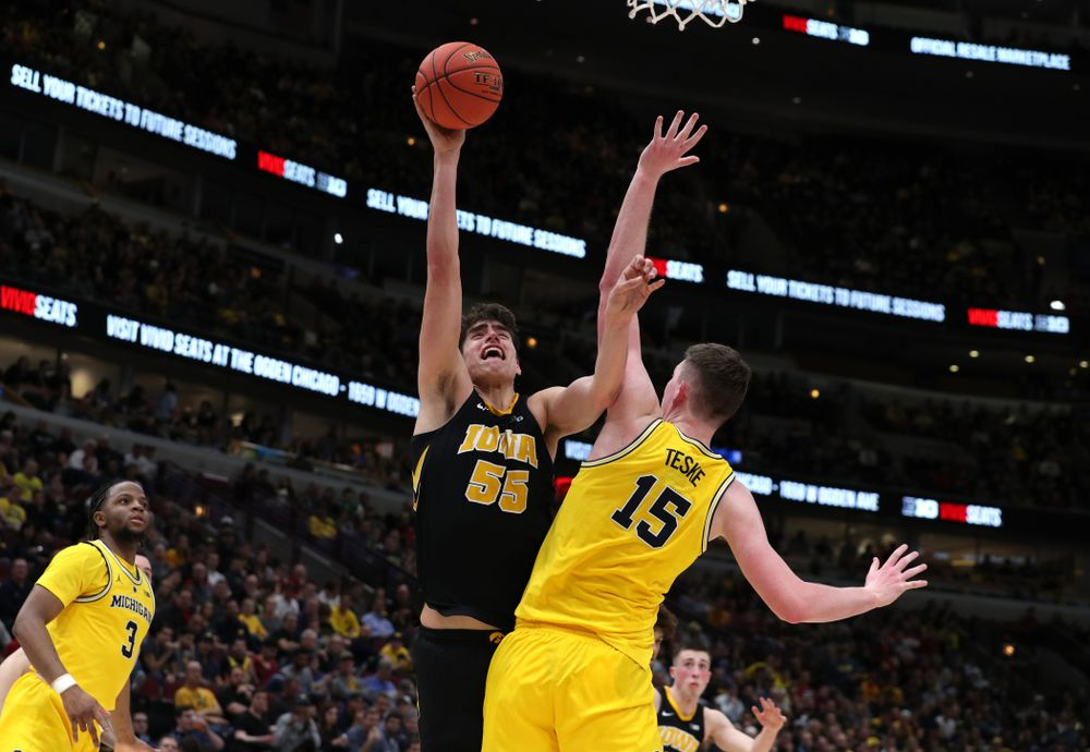 Iowa Hawkeyes forward Luka Garza (55) against the Michigan Wolverines in the 2019 Big Ten Men's Basketball Tournament Friday, March 15, 2019 at the United Center in Chicago. (Brian Ray/hawkeyesports.com)
