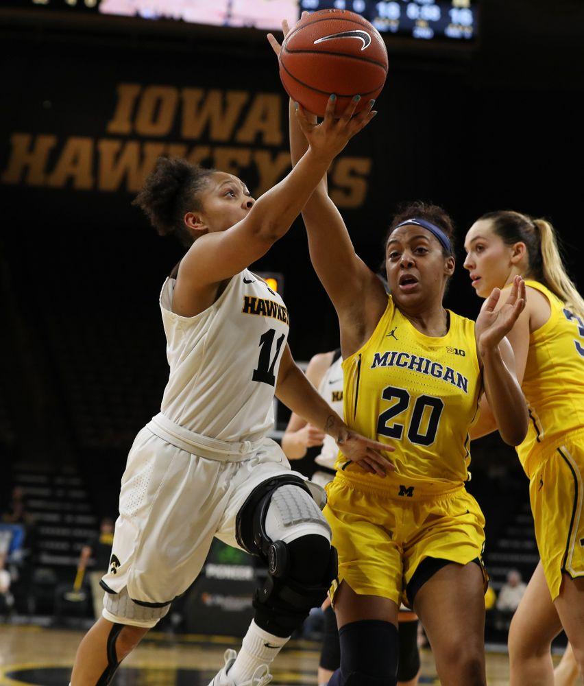 Iowa Hawkeyes guard Tania Davis (11) against the Michigan Wolverines Thursday, January 17, 2019 at Carver-Hawkeye Arena. (Brian Ray/hawkeyesports.com)